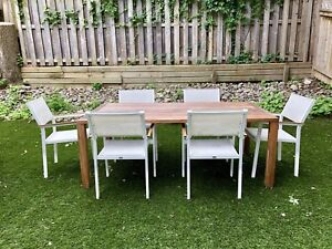 Gloster teak table and 6 chairs