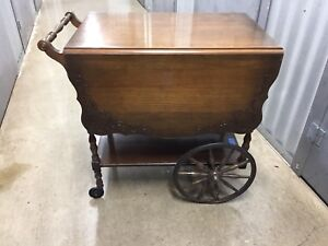 Antique tea wagon with glass tray