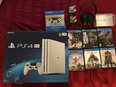 ps4 pro 1tb glacier white with 2 controllers and new games