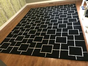 Black and white wool rug.