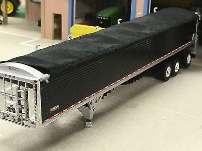 1/64 DCP BLACK WILSON 50' PATRIOT TRI-AXLE BELT TRAILER W/ SUPER SINGLES