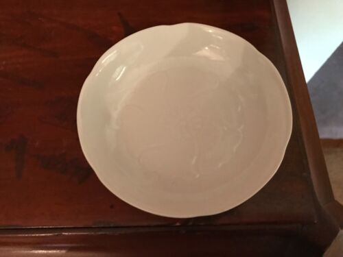 Oriental white porcelain lotus embossed plate