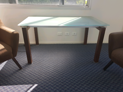 Glass top desk and two big arm chairs