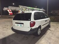 2003 Dodge Caravan with metal shelving and all 7 seats