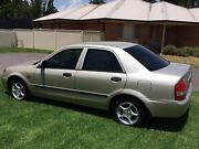Mazda Bj 323 Protoge 2002 5spd A/C  URGENT SALE Llanarth Bathurst City Preview
