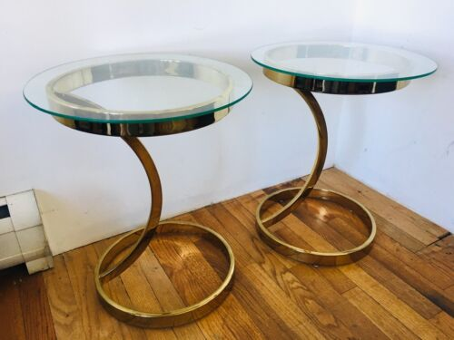 Hollywood regency Brass and glass side tables a pair