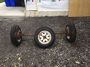 Trailer axle with tires and spare