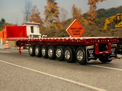 1/64 DCP RED 53' WILSON ROAD BRUTE 7 AXLE FLATBED TRAILER W/ BULKHEAD