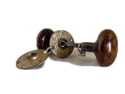 Pair of Bennington Style door knobs with Antique irn shanks and plate rosettes