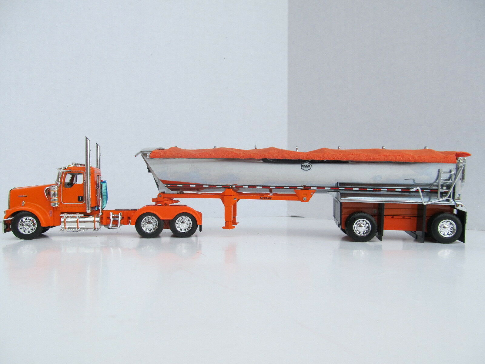 DCP 1/64 SCALE W-900 KENWORTH DAY CAB ORANGE WITH MAC ROUND BOTTOM SPREAD AXLE