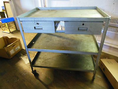 Utility Table With Wheels Two Drawers And Three Shelves