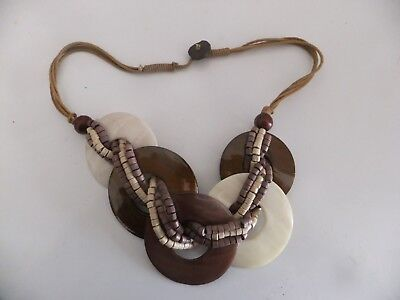 MULTI RING FEATURE NECKLACE ENTWINED WITH WOODED BEADS AND ON LEATHER THONGS Entwined Rings Necklace
