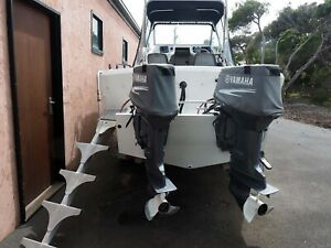 6 metre plate aluminium boat with twin 70HP Yamaha outboards.