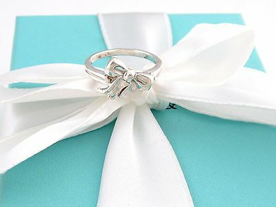 Tiffany Bow Ring (TIFFANY & CO SILVER BOW RIBBON RING BAND SIZE 5 POUCH)