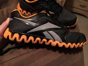 Orange and black reebok shoes good condition
