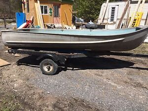 Fishing boat with motor an trailer