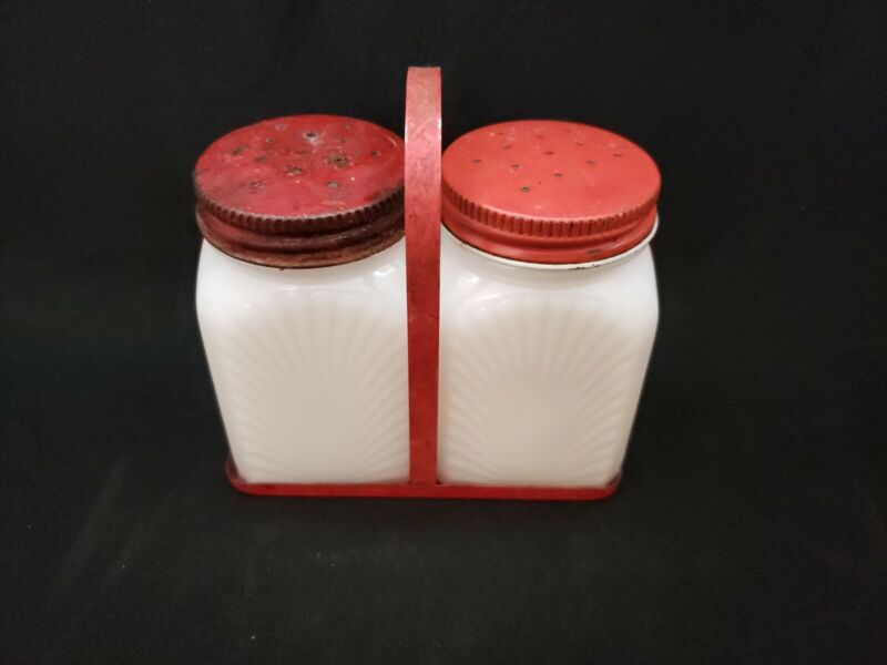 2 Vintage Depression White Milk Glass shakers with red metal lids and caddy
