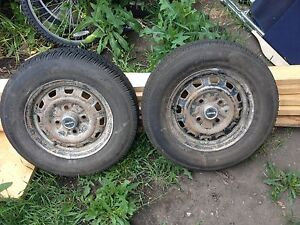 2 185/70R/13 Tires mounted on 4 bolt steel rims