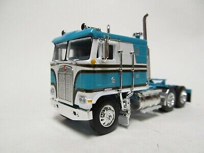 DCP / FIRST GEAR 1/64 SCALE KENWORTH K-100 FLAT TOP, TEAL & WHITE, BLACK STRIPES