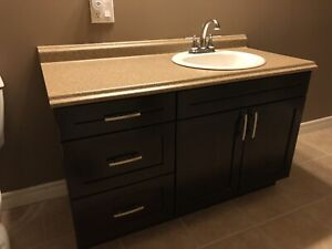 Sold***Bathroom cabinet w/ sink, faucet, and countertop.