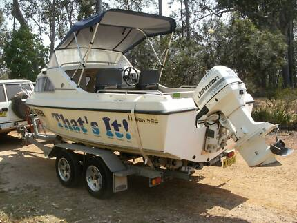 Half Cabin Runabout with outboard & dual axle trailer