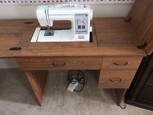 Sears Kenmore sewing machine in cabinet
