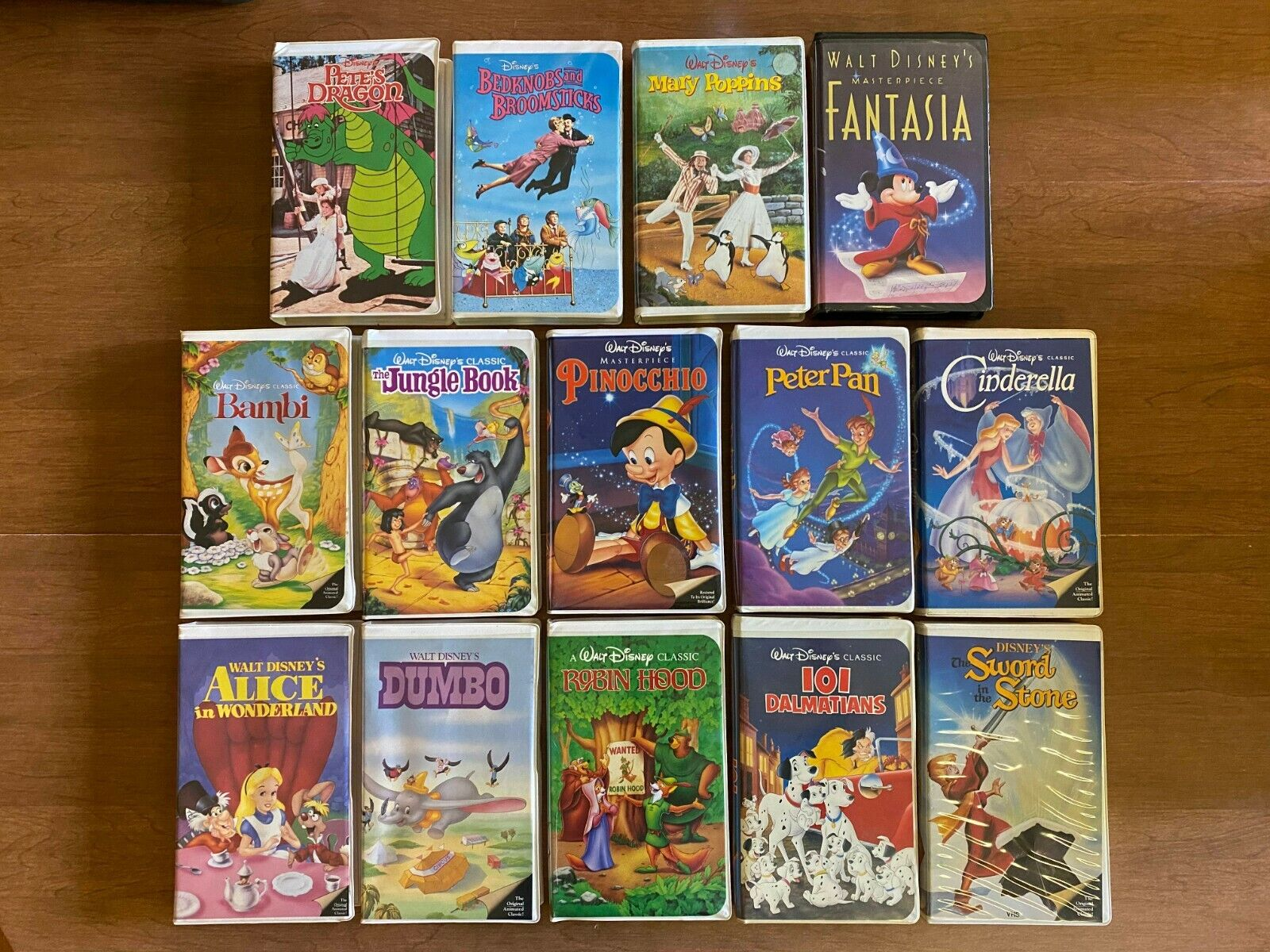 Lot Of 14 Walt Disney Classic Movies VHS Pete s Dragon Bambi Robin Hood More - $13.95