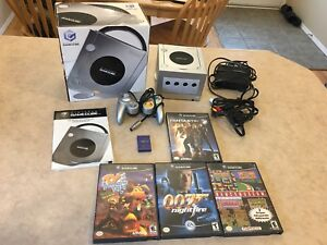 Silver Nintendo game cube in the box