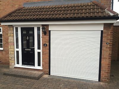 ELECTRIC GARAGE DOOR 9 FT X 8FT NEW  INSULATED WITH 2 REMOTES CE MARKED
