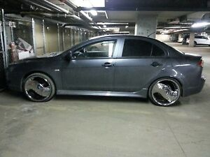 """Greed deuce chrome 20"""" rims and low pro tires"""