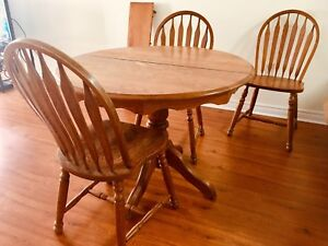 MOVING SALE: Oak Table and Chairs (plus extra chair and leaf)
