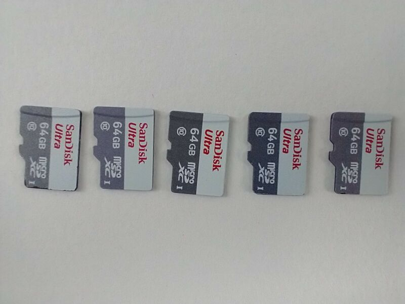 SanDisk 64gb micro sd. LOT OF 5 USED white