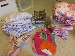 Assorted baby blankets/bibs/crib sheets