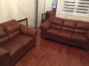 Brown leather couches excellent condition.