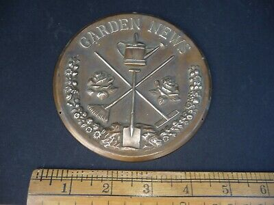 Antique / Vintage Brass 'Garden News ' plaque with relief design - Spade / Rake