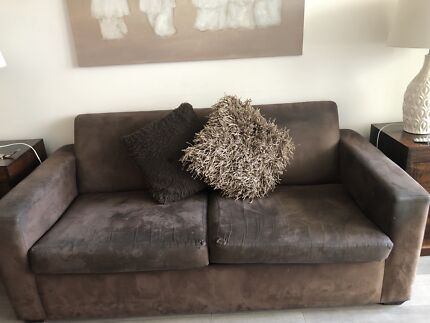 Brown suede sofa that pulls out into a bed