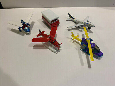 FOUR MATCHBOX AIRPLANES AND A TRAVEL TRAILER