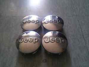 4X JEEP CENTER CAPS sale or swap for 4 jeep silver center caps Ballajura Swan Area Preview