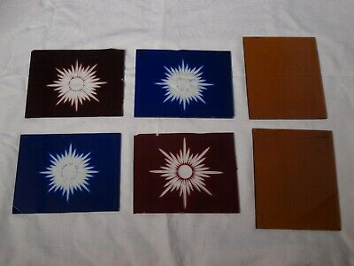 Four stained glass glory stars plus two plain amber panes