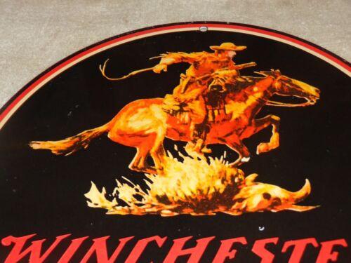 VINTAGE WINCHESTER WESTERN HORSE MAN GUN 11 3/4 PORCELAIN METAL HUNTING GAS SIGN
