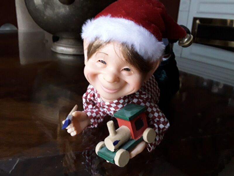 Adorable Christmas Elf Holding Toy Train