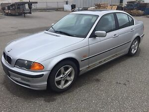 2000 BMW 328i needs to go.