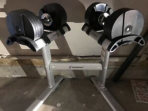Adjustable weights and stand (new condition)