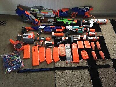 Nerf Gun lot - includes 7 guns, 11 attachments, 12 clips, 120+ bullets & more