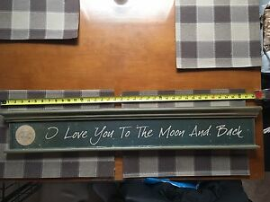 """I love you to the moon and back"" wooden sign"