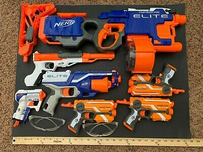 Lot: 7 Nerf guns and 250 Nerf bullets, child toy age 14+, 2 eye glasses