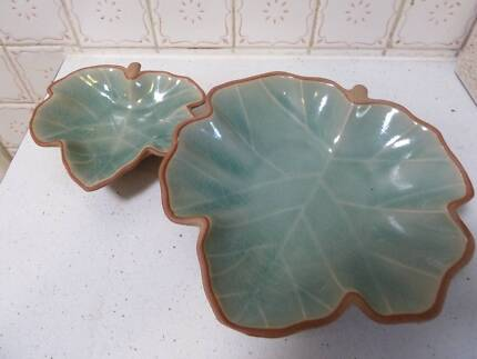 Matching leaf design pottery display plates
