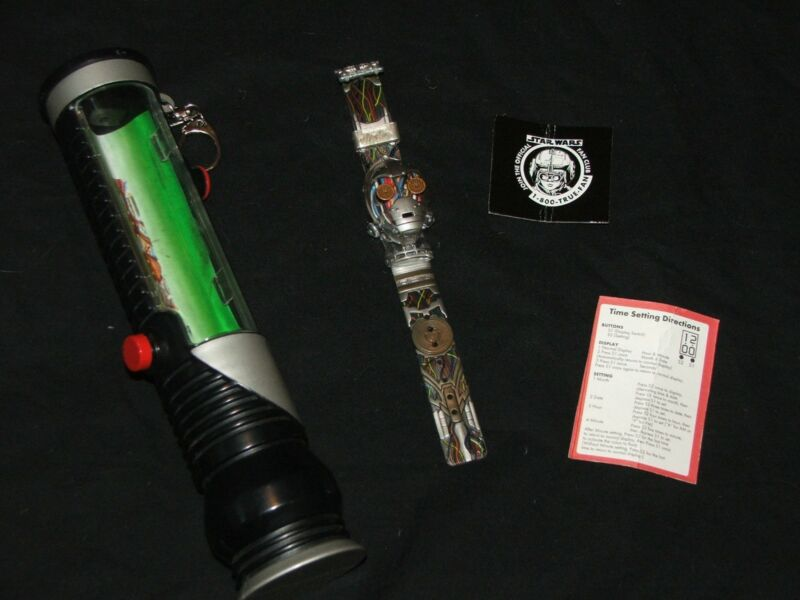Star Wars C-3PO watch with light saber container. (New Battery)