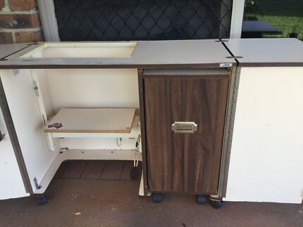 Old horn sewing Cabinet large lots of storage but old 100% works