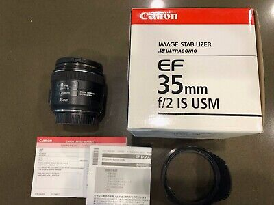 Canon EF 35 mm f/2.0 IS UMS lens with B+W UV Filter & Canon Hood